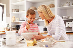 Mother and son baking together at home Stock Images