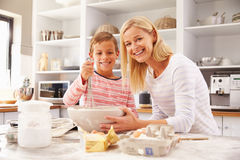 Mother and son baking together at home royalty free stock photography