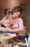 Mother and son baking. Together in kitchen Royalty Free Stock Photography
