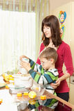 Mother and son are baking Stock Image