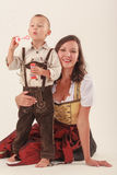 Mother and son in Bavarian costume Stock Images