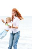 Mother and son on beach Royalty Free Stock Photography