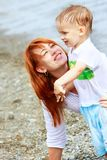 Mother and son on beach Royalty Free Stock Image