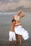 Mother and son on the beach Stock Photos