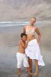 Mother and son on the beach Royalty Free Stock Image