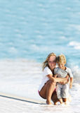 Mother and son on beach Stock Images