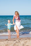 Mother and son  on the beach. Stock Photos