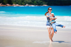 Mother and son at beach Stock Images