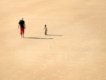 Mother and Son on Beach. Walking on sand stock photos