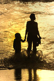 Mother and son in the beach Stock Photos
