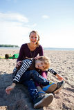 Mother and son at beach. Royalty Free Stock Image