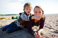 Mother and son at beach. Royalty Free Stock Photo