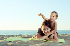 Mother with son on the beach. Mother with her son on the beach royalty free stock image