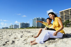 Mother and son at the beach Stock Photography