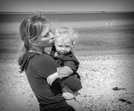 Mother and Son at the Beach. A Mother and Son Embracing at the Beach Royalty Free Stock Photos