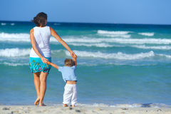 Mother and son on the beach Royalty Free Stock Photography