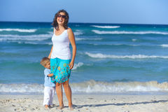 Mother and son on the beach Stock Image