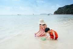 A mother and son on beach outdoors Sea and Blue sky royalty free stock photography