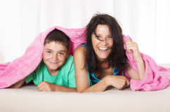 Mother and son in bed Royalty Free Stock Photo