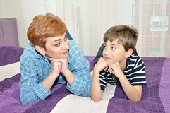 Mother and son in bed Royalty Free Stock Image
