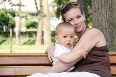 Mother and son on bench Royalty Free Stock Photos