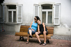 Mother and son on bench Stock Photo