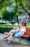 Mother and son on bench in park Stock Photos