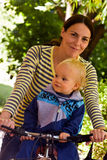 Mother and son on bicycle Royalty Free Stock Image