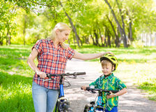 Mother and son on the bikes in the park Stock Image