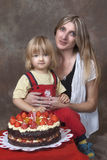 Mother and son with birthday cake Stock Photography