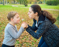 Mother and son blowing dandelion Stock Photography