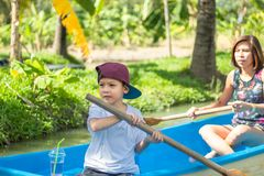 Mother and son boating on the park. stock photography