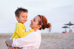 Mother an son bracing on the beach Royalty Free Stock Images