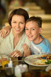 Mother and son at breakfast Royalty Free Stock Photography