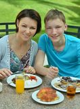 Mother and son at breakfast Royalty Free Stock Photo