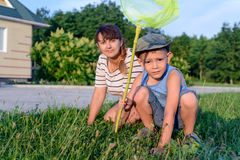 Mother and Son with Bug Net Exploring on Lawn Stock Images