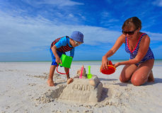 Mother and son building sand castle on summer Royalty Free Stock Photo