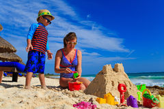Mother and son building sand castle on tropical Stock Photography