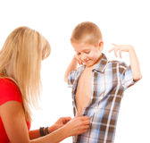 Mother and son buttoning on shirt isolated Stock Image