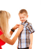 Mother and son buttoning on shirt isolated Royalty Free Stock Photo