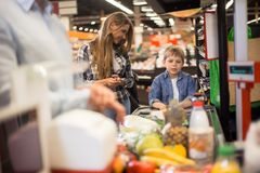 Mother and Son Buying Groceries Royalty Free Stock Photos