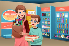 Mother and son buying school supplies Royalty Free Stock Images