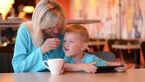 Mother with the son in cafe stock video footage