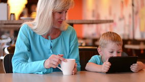 Mother with son in cafe stock video