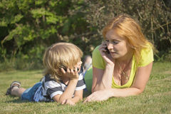 Mother and son are calling outdoors. Royalty Free Stock Photos