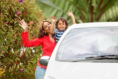 Mother and son with a car Stock Photos