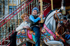 Mother and son on carousel Stock Image