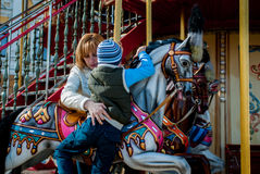 Mother and son on carousel Stock Photo