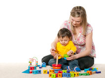 Mother and son on the carpet with toys Stock Photo