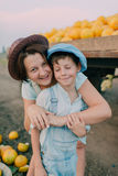 Mother and son in the cart with melons Stock Photos